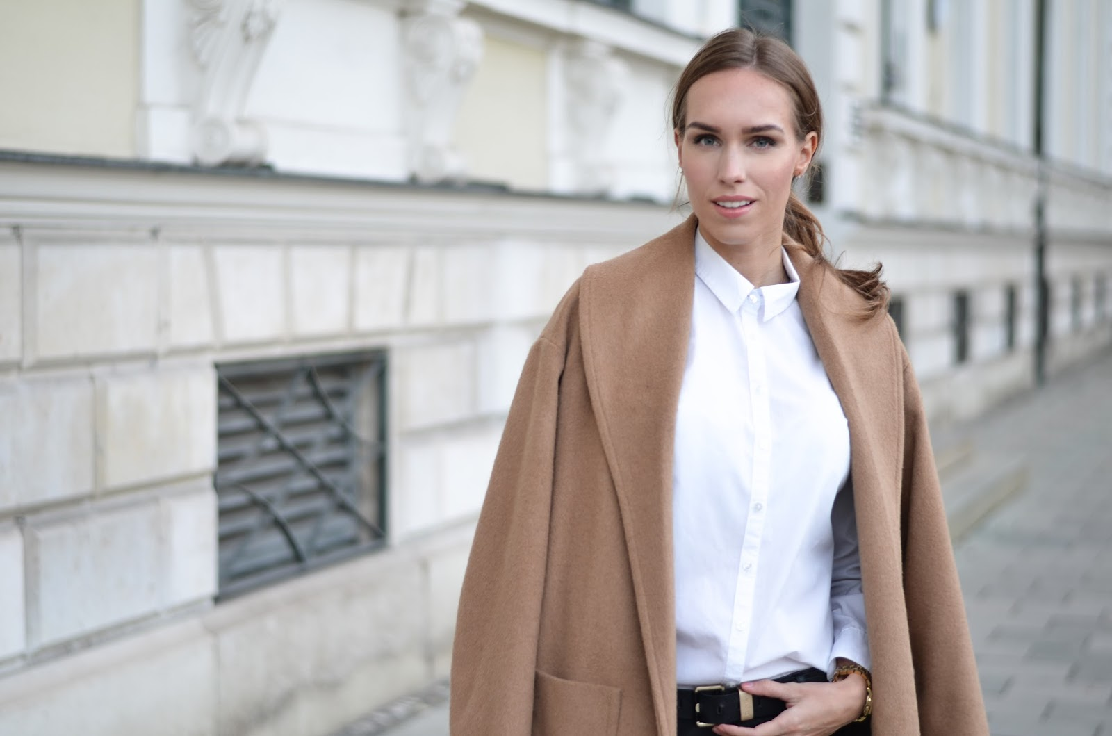 kristjaana mere camel coat white button down shirt minimalist fall winter outfit