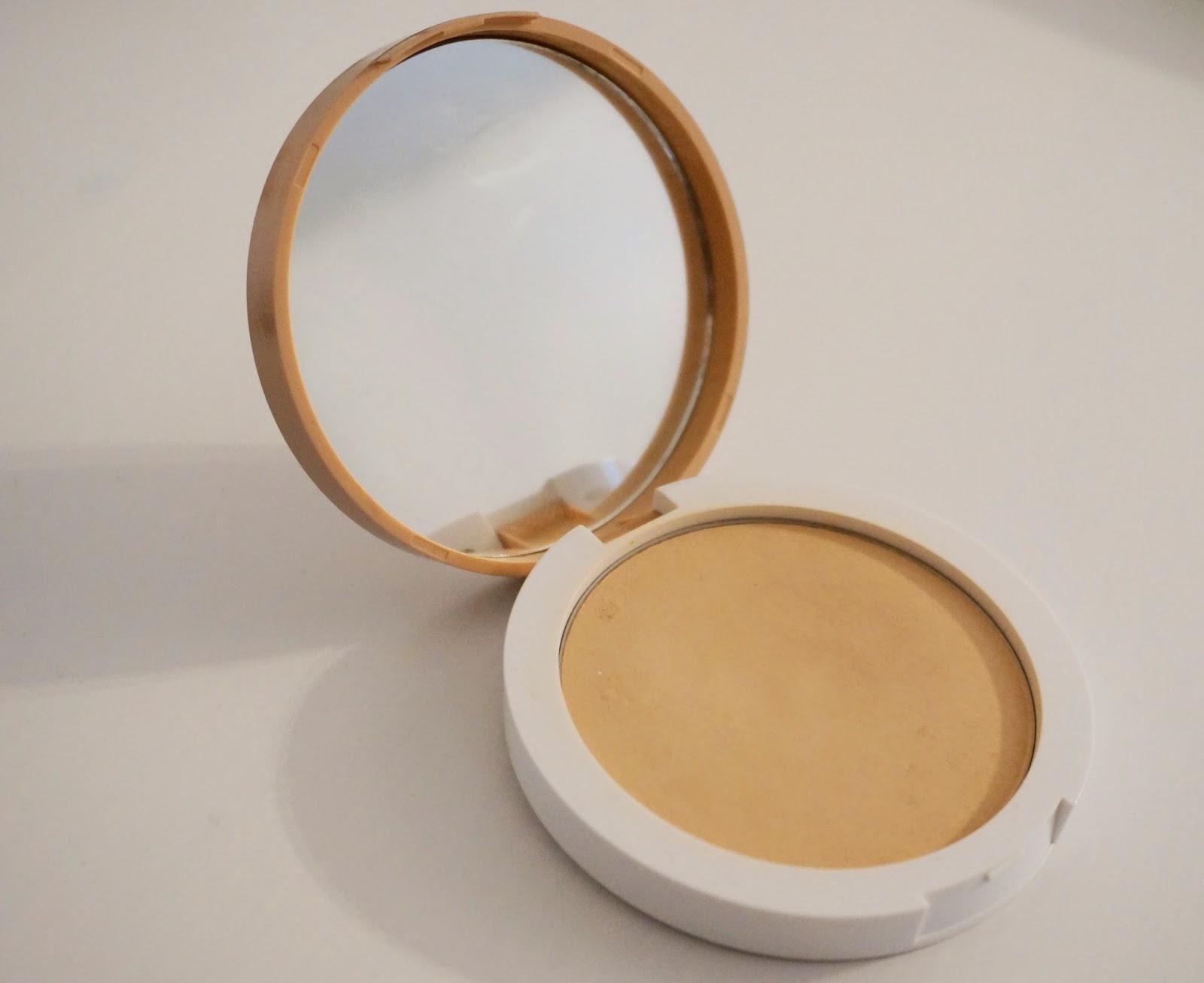 A picture of lumene touch of radiance matt powder foundation in 01 cream beige