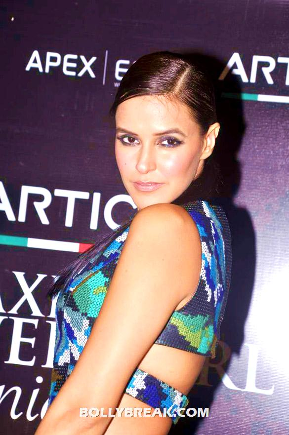 Neha Dhupia side pose showing back - (2) - Neha Dhupia at Maxim