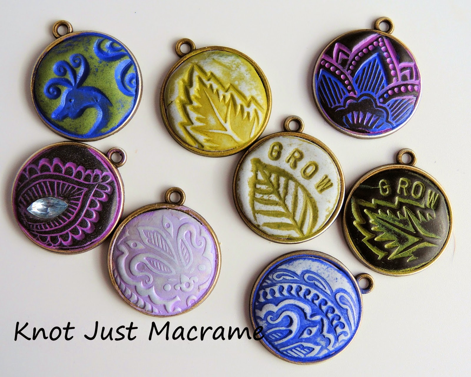 Epoxy clay charms stamped and antiqued with Vintaj patinas