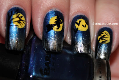 Halloween nail art with witches, trees and bats.
