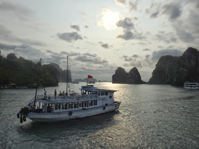 Sailing back to Halong Bay Ferry Terminal during sunset in Hanoi, Vietnam
