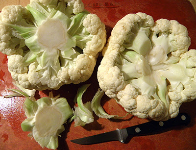 2 Cauliflowers on Cutting Board with one Core Removed