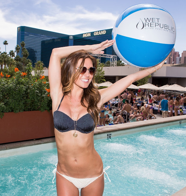 Audrina Patridge with blue and white beach ball at Wet Republic