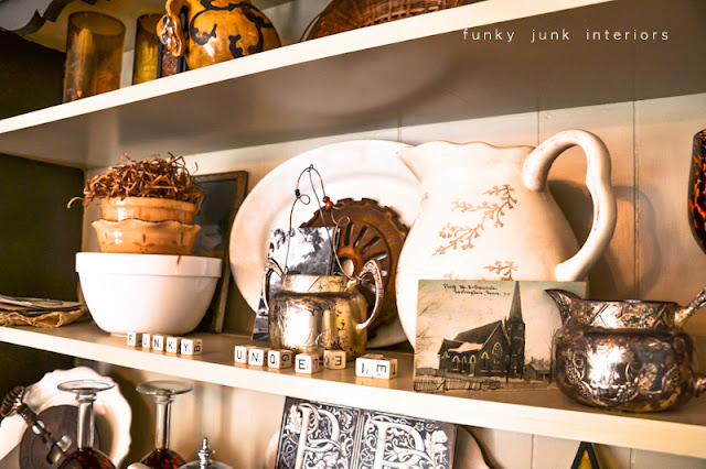 A junk tour of Bella Rustica Linda's house via Funky Junk Interiors - hutch full of cool junk