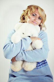 Woman hugging a teddy bear.