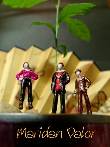 My lemon tree and tiny figures. Is that Slender man in brown...or a watcher? Who could it be beneath the lemon tree?