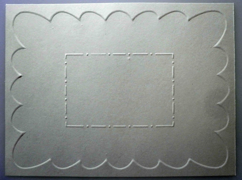 remove stencil and realign with the embossing on the back of the card  title=