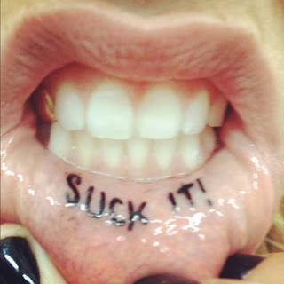 ke$sha's suck it tattoo