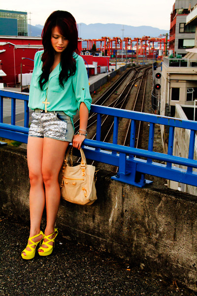 Necessary Clothing Seafoam green shirt with gold buttons, Necessary Clothing glitter shorts, Vintage gold cross necklace, Tobi yellow pumps, Balenciaga Sahara city with Giant Gold Hardware, Designer Purse, Street Style, Fashion, Funky, sexy, stylish, Vancouver
