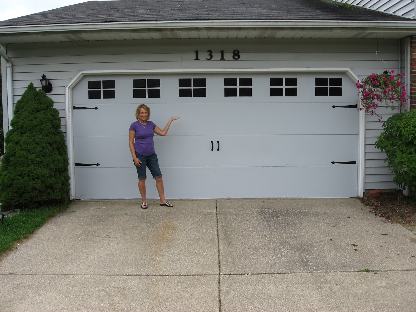 Betwixt home and school faux carriage garage door for Faux painted garage doors