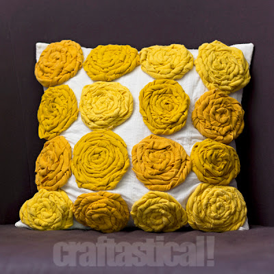 handmade pillow with wrapped roses made of upcycled t-shirts