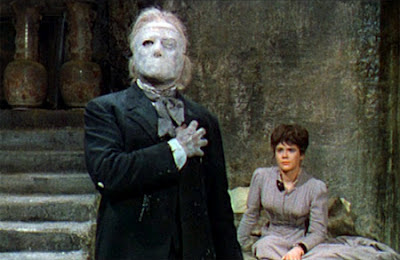 The Phantom (Lom) and Christine (Heather Sears) in the Phantom's lair