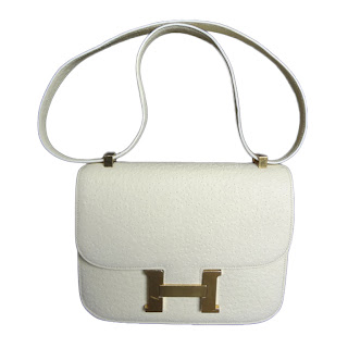 "Vintage 1980's white whale skin Hermes Constance bag with signature gold ""H"" hardware."