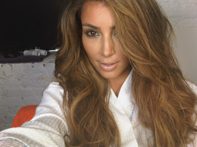 Kim Kardashian in a pretty caramel look that I believe is a wig.
