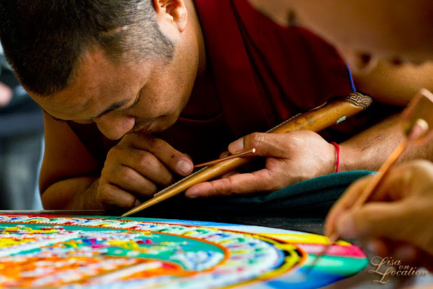 Monks from the Drepung Loseling Monastery, India, create a mandala of sand in the LBJ Student Center at Texas State University. Tibetan monks. Lisa On Location photography, 365