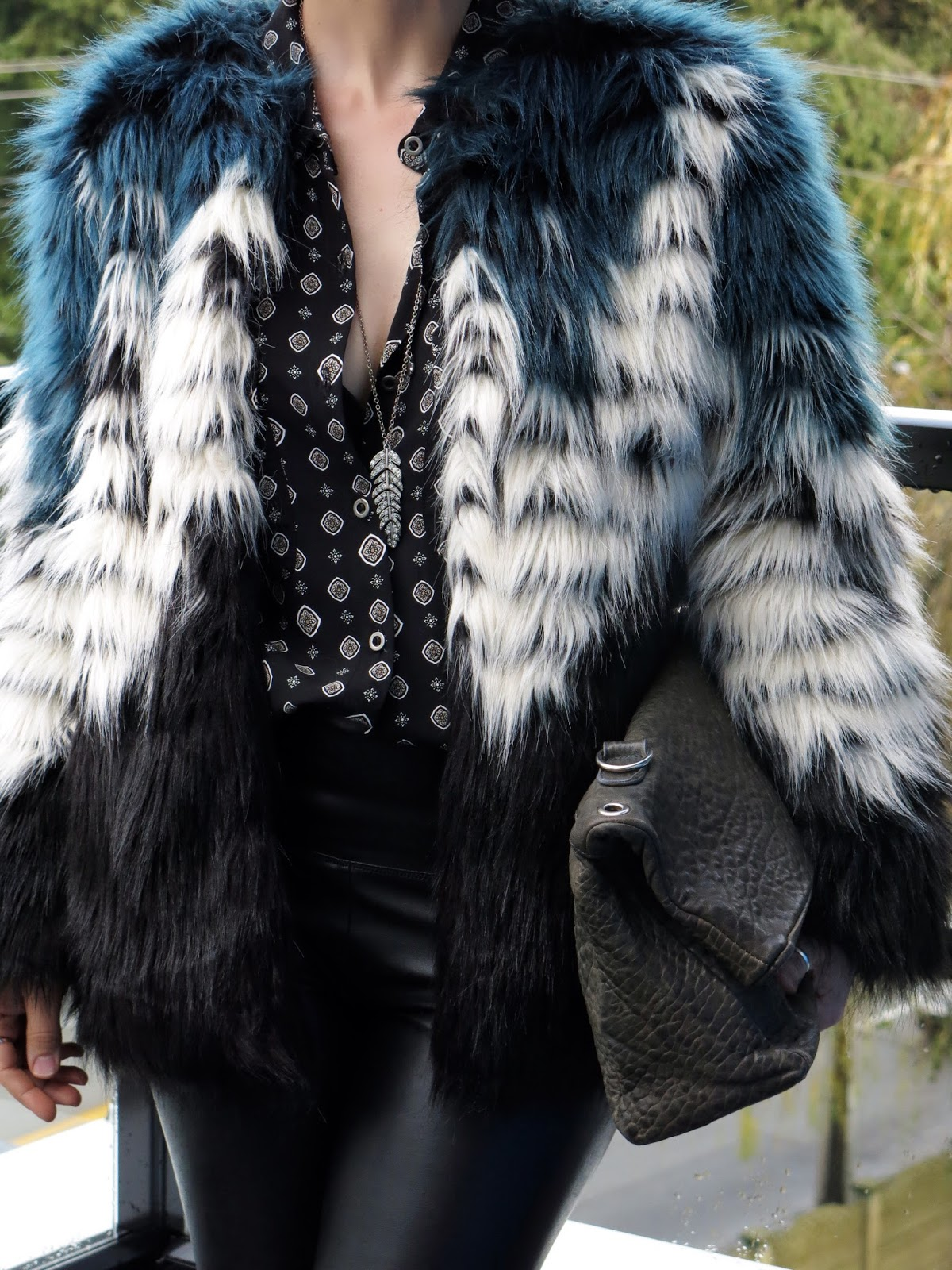 patterned shirt, faux-fur jacket, pebbled leather clutch