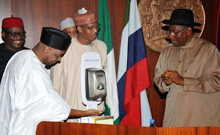 Vice president Sambo using hand sanitizer