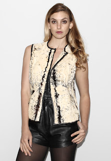 Vintage 1950's black and white marbled cowhide vest with hook front closure.