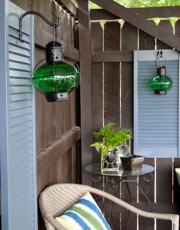 http://www.salvagesavvy.com/2014/07/diy-idea-hang-lanterns-on-shutter.html