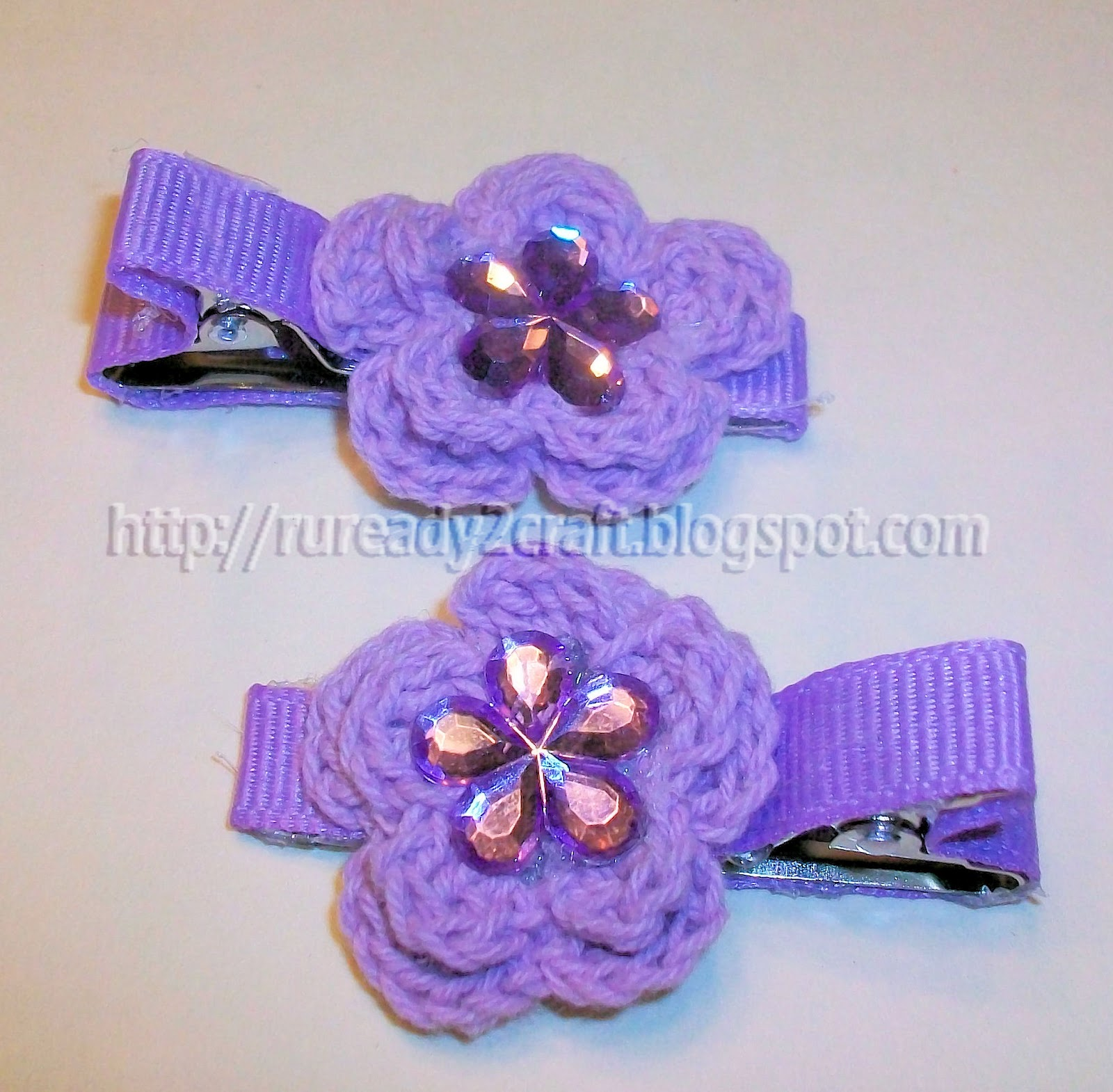 Completed project. Embellished crochet flower hair bows.