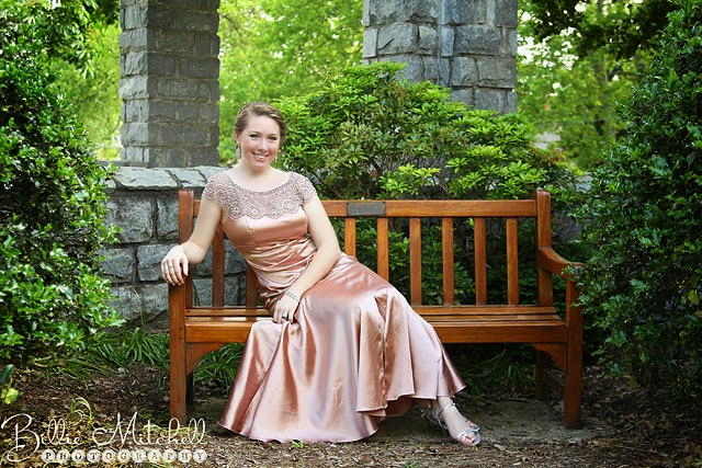 teen in champagne vintage prom gown sitting on wooden bench