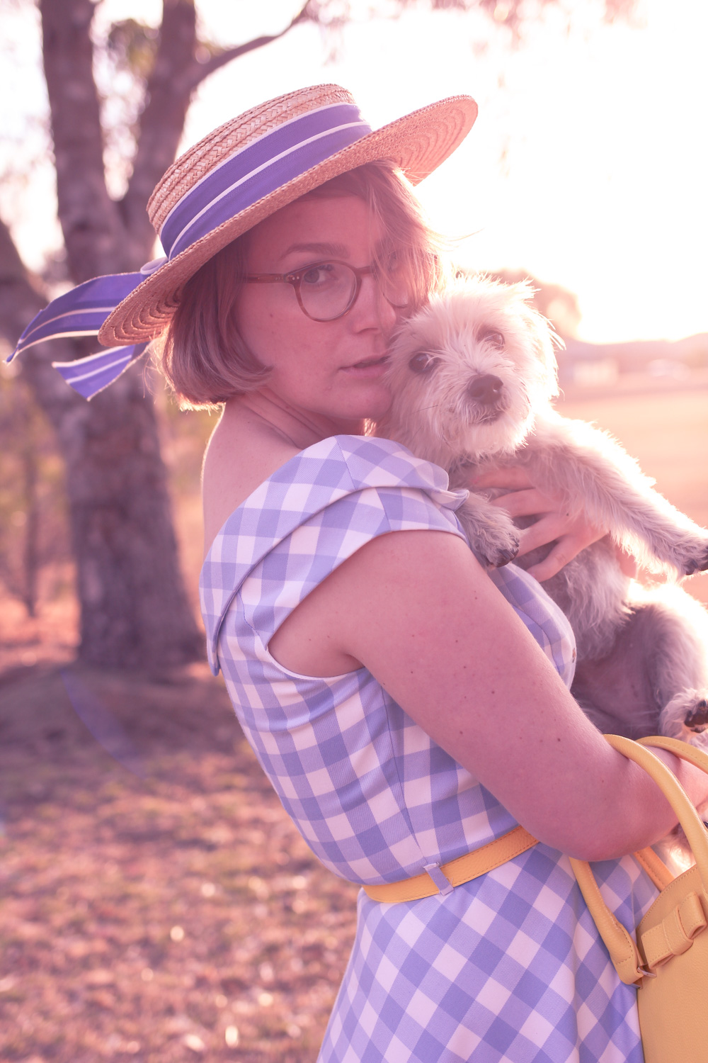 @findingfemme wears blue gingham Review Australia dress with vintage Laura Ashley straw boater hat.