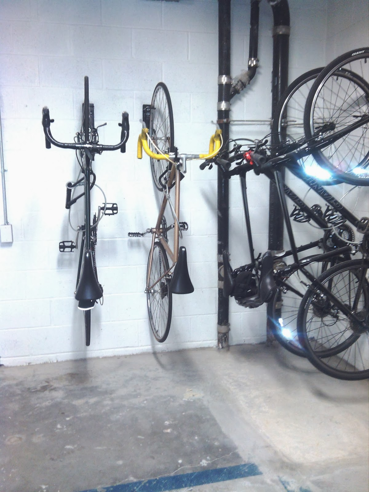 Wall Mount Bike Brackets Installed In Woodside Provide Maximum Storage, In  The Smallest Footprint. Wall Mount Bike Brackets Allow Bikes To Be Stored  Just 12 ...