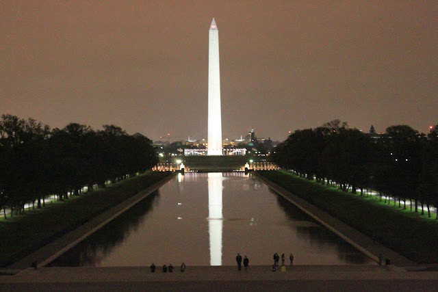 Washington Monument was taken from Lincoln Memorial at night in Washington DC, USA