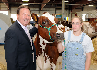 Gene Cassidy with Cow and 4-H member