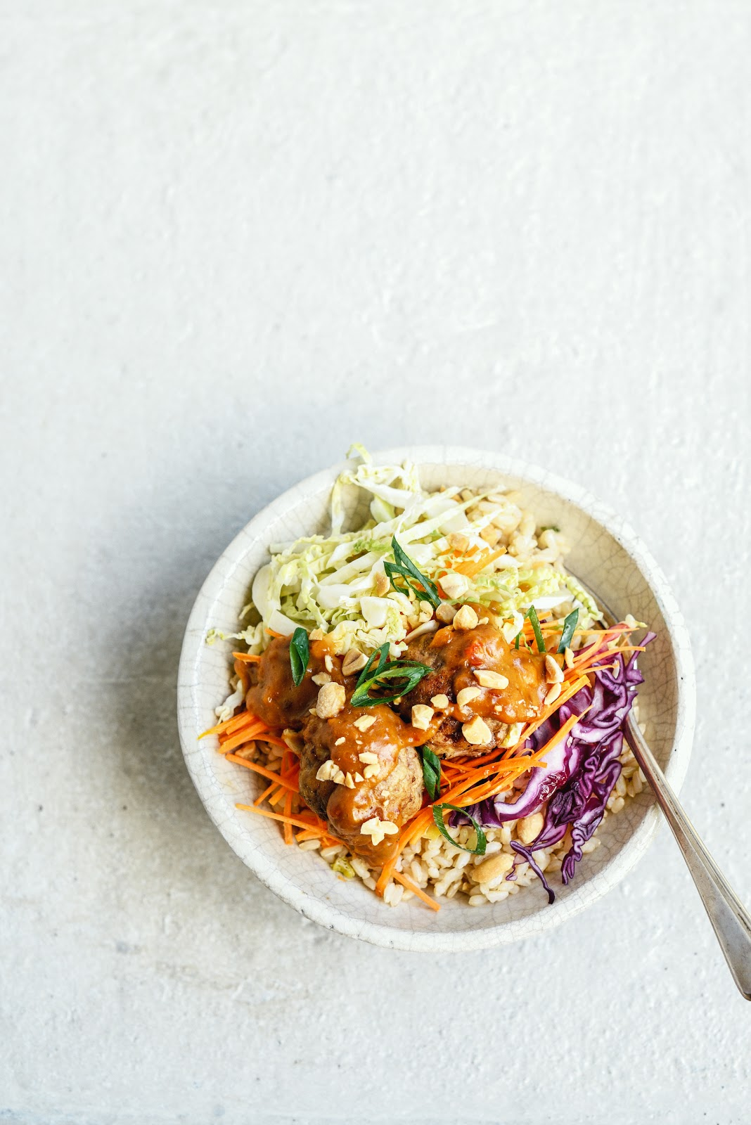 ... The Kitchen: Meatballs on Brown Rice with Peanut Sauce and Asian Slaw
