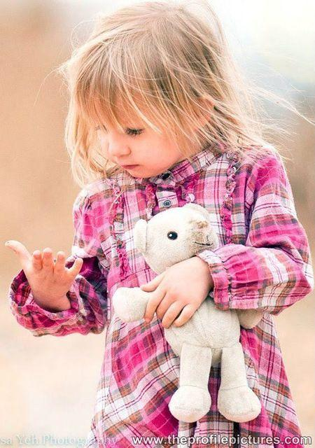 Cute Little Girl With Doll