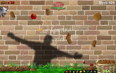 Screen shot of Paximadaki, a highly accessible Kinect game that takes into account a broad range of abilities and alternative control methods. The screen shot is of a shadow against a wall, trying to guide falling fruit into a wicker basket.