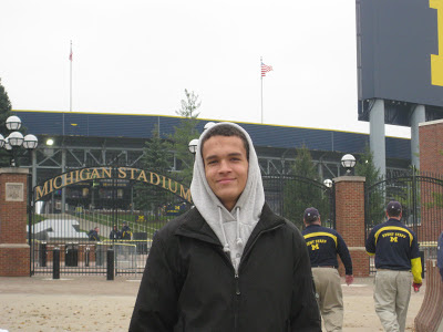 Derek Kief standing in front of the Big House on unofficial visit