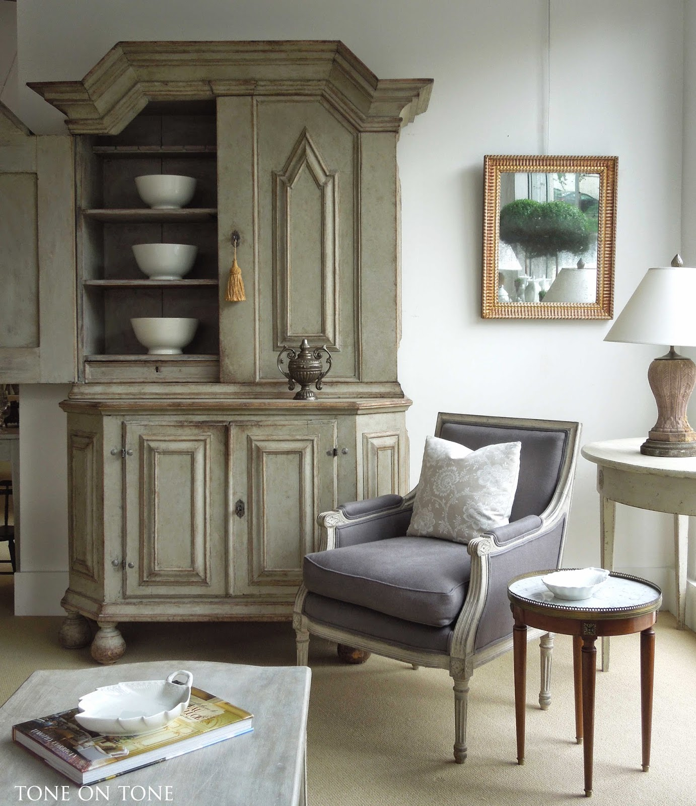 A room setting featuring a 1750s Swedish Baroque cupboard, pair (only one  shown) of French painted bergeres with new blue-gray linen upholstery, ...