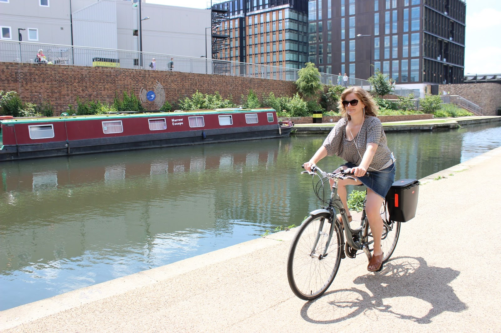lady cycling by canal