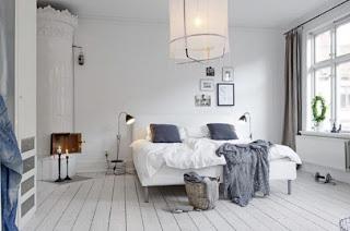 cozy scandinavian bedrooms 12 554x367 Dekorasi kamar tidur untuk cuaca dingin