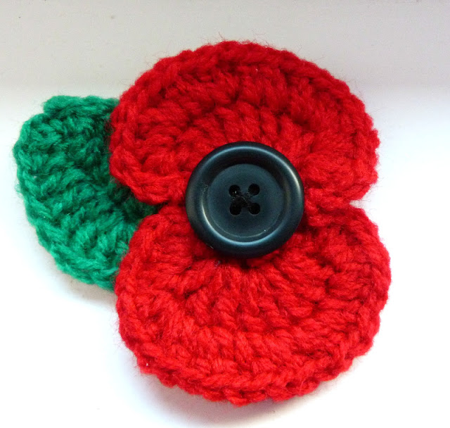 Link to a free crochet pattern to make a yarn poppy badge for Remembrance Day. secondhandsusie.blogspot.com