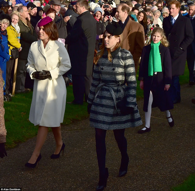 Britain's Prince William, Duke of Cambridge, and his wife Catherine, Duchess of Cambridge, leave after attending with other members of the royal family the traditional Christmas Day Church Service at Sandringham in eastern England, on Dec. 25, 2014.