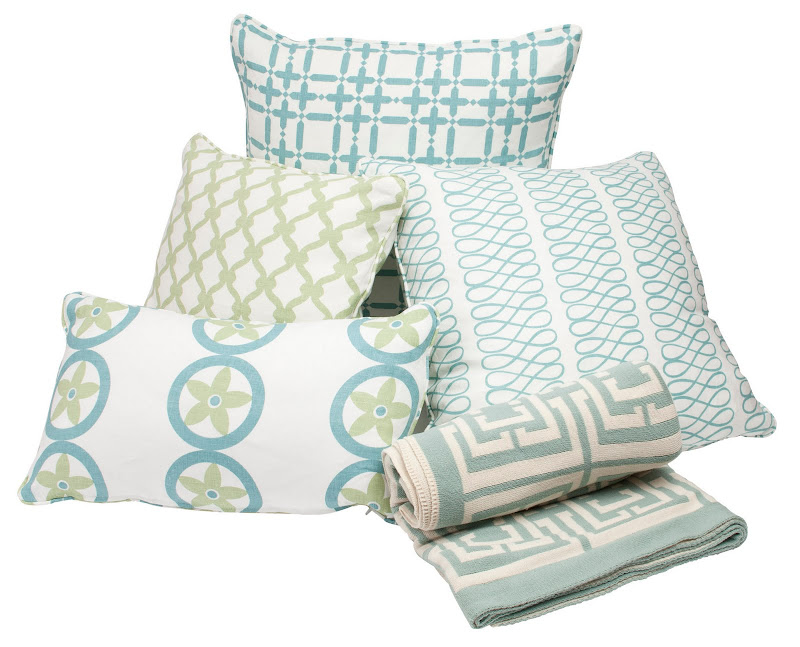 COCOCOZY Logo Throw in Light Blue surrounded by four COCOCOZY pillows