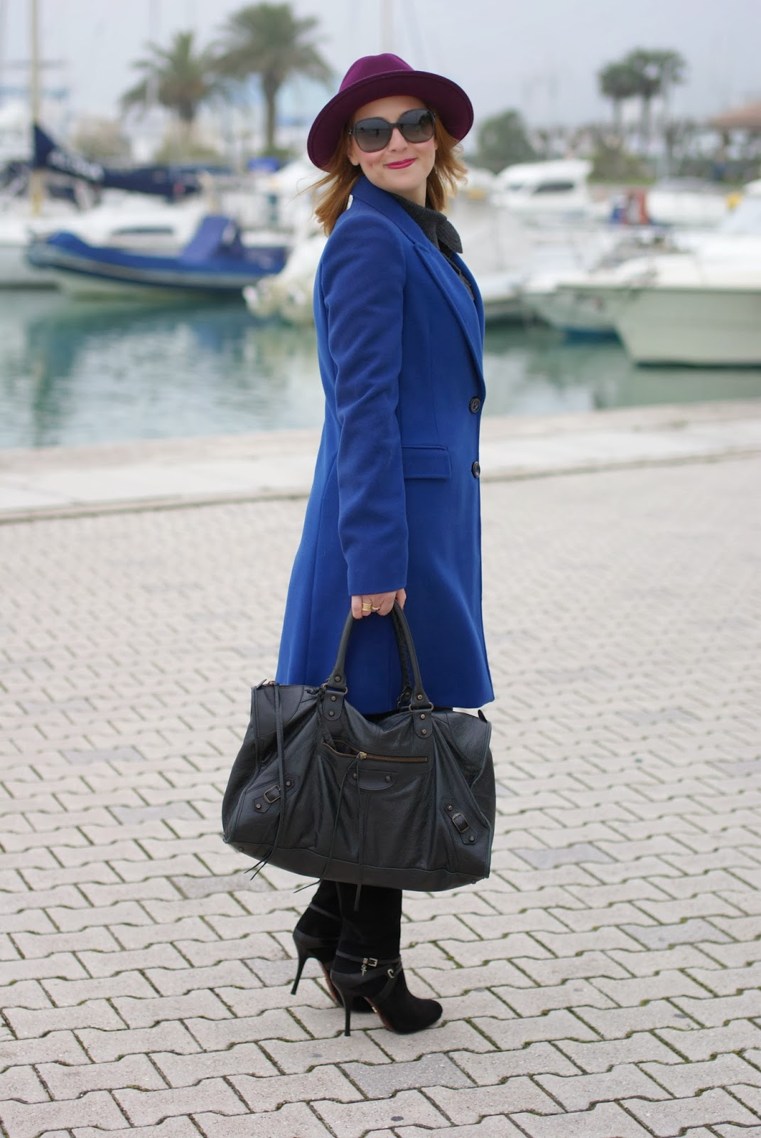 Ecua-Andino hat, cobalt blue coat, Balenciaga work bag, Fashion and Cookies, fashion blogger