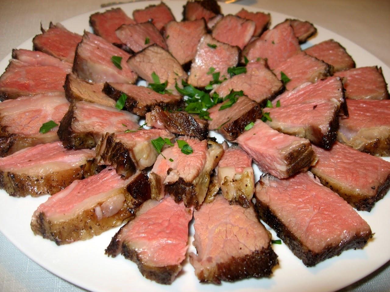 Platter of Roast Beef Arranged in a Pinwheel Shape