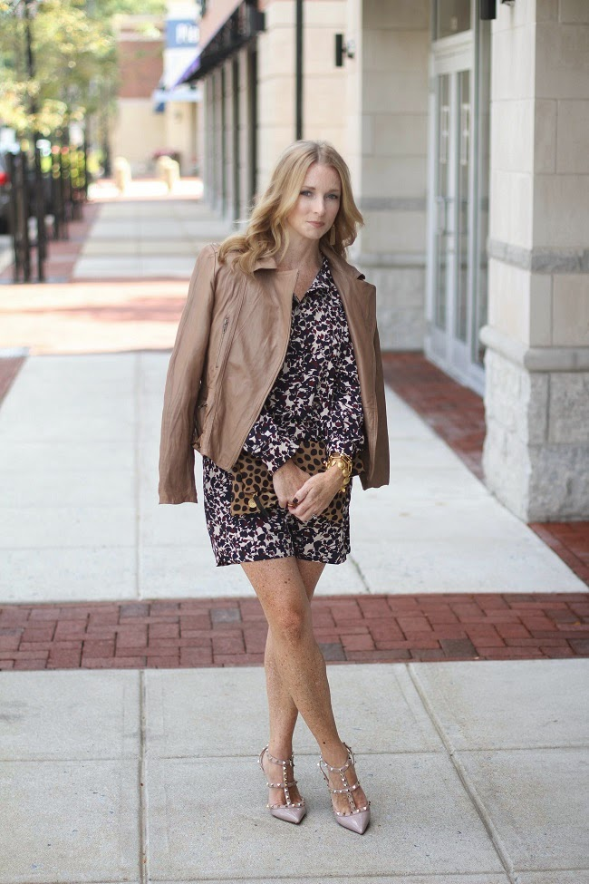 beige leather jacket, loft floral romper, valentino rockstud heels, clare v leopard clutch, jcrew tassel earrings