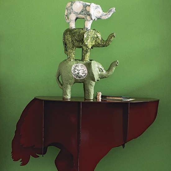 Safari Fusion blog | Elephant on an ostrich | Ceramic African elephant sculpture displayed on an ostrich table