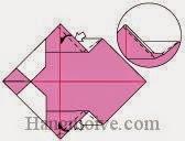 Bước 6: Từ vị trí mũi tên mở hai lớp giấy, kéo và gấp lớp giấy vào trong.