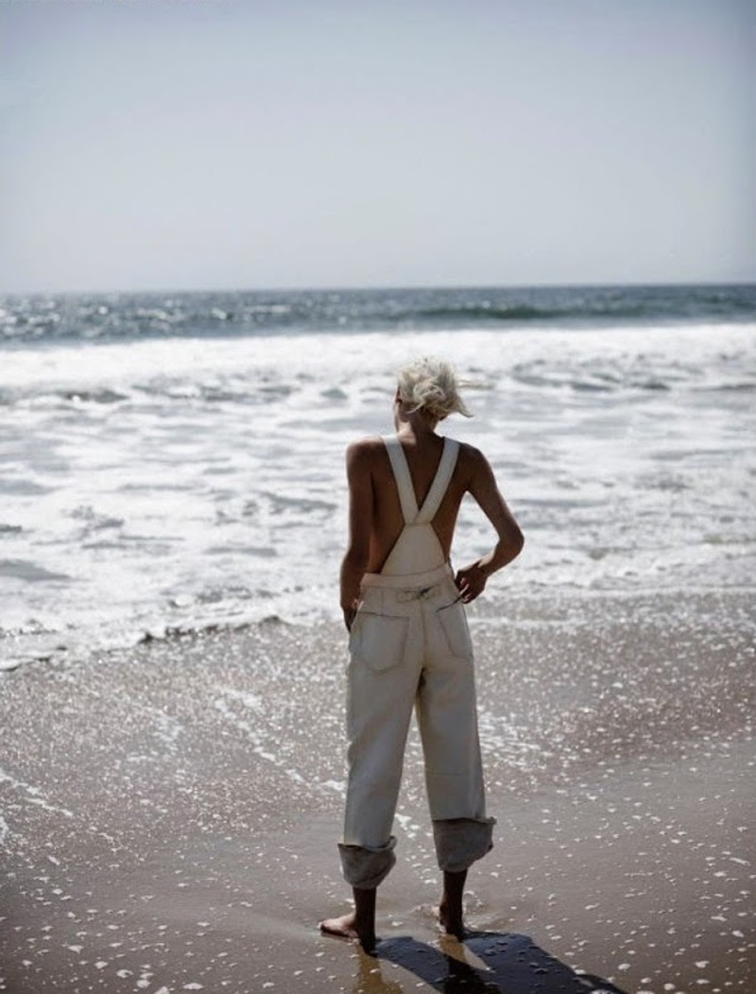 Aline Weber for Vogue Netherlands on the beach in Yang Li white overalls photographed by Annemarieke Van Drimmelen, styled by Dimphy Den Otter