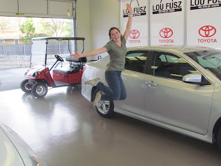 Vehicle delivery, new car shopping, excited girl with car