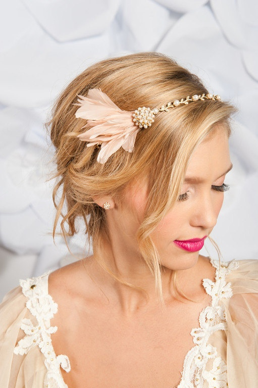 Cutting long hair into a bob right before your wedding would be a pretty drastic move. If you love the look of chin-length hair but want to keep yours long, try this romantic, Gatsby-inspired faux.