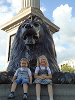 Top Ender and Big Boy in front of a Trafalgar Square Lion