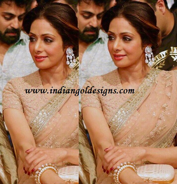 Latest saree designs sridevi in beige netted work saree checkout actress sridevi in beige netted work saree with work border and paired with lacework short sleeves blouse altavistaventures Images